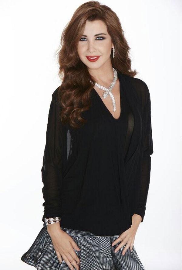صورالفنانة اللبنانية نانسي عجرم صورة جديدة على صفحتها الرسمية على موقع 'إنستجرام'، وهي برفقة زوجها 2014 image.php?token=067d00779de358bed73deefeeb11730d&size=