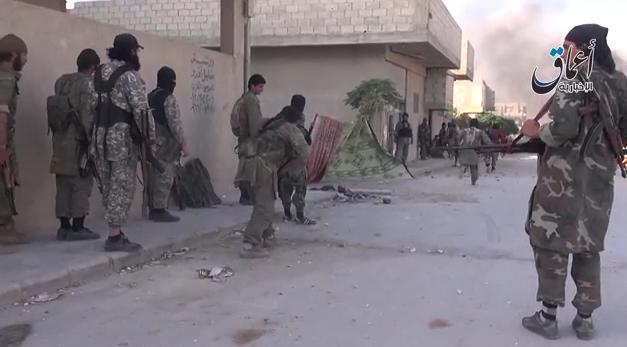 """بالفيديو  عناصر ''تنظيم الدولة'' وسط  بلدة  عين العرب """"كوباني"""""""