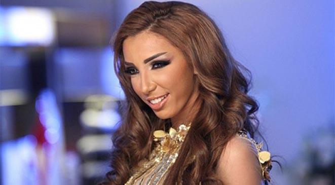 "دنيا بطمة: كارمن سليمان ""موديل"" مع محمد عبده"