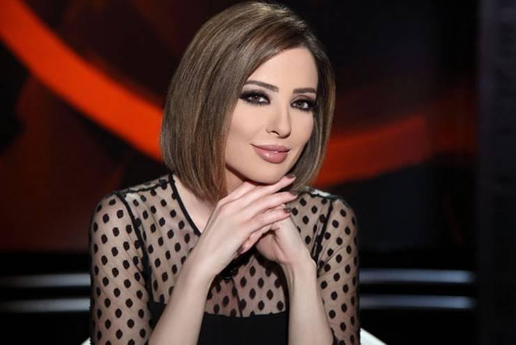 صورة قديمة لوفاء الكيلاني بشعر أشقر قصير وغريب ..  وهكذا كان شكلها!
