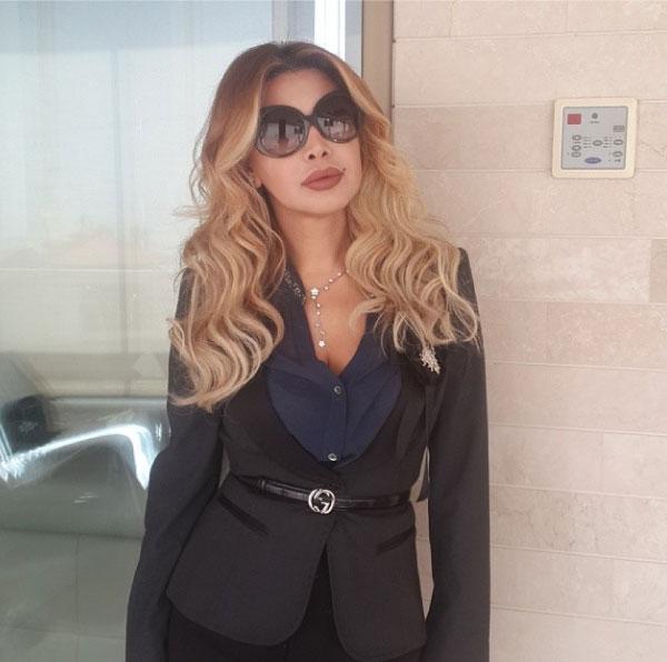 صور نوال الزغبي تستعرض فيها إطلالتها في عزاء والدة رامي عياش 2014