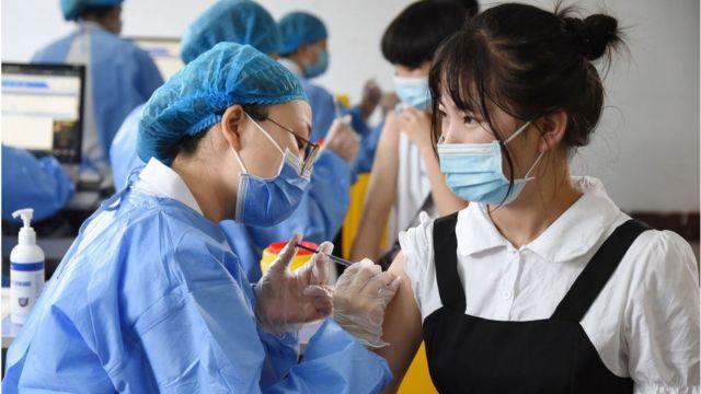 الصين تسعى لاحتواء أسوأ موجة للوباء  ..  كورونا يتفشى في 14 مقاطعة صينية