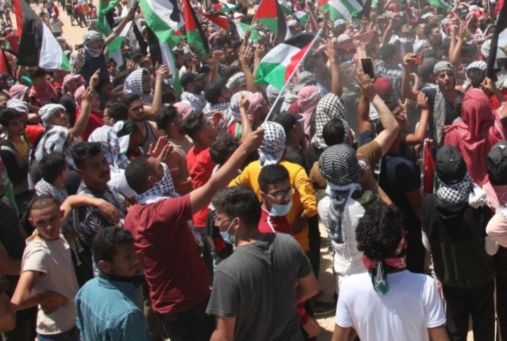 إربد: وقفة شبابية تضامنا مع القدس وغزة