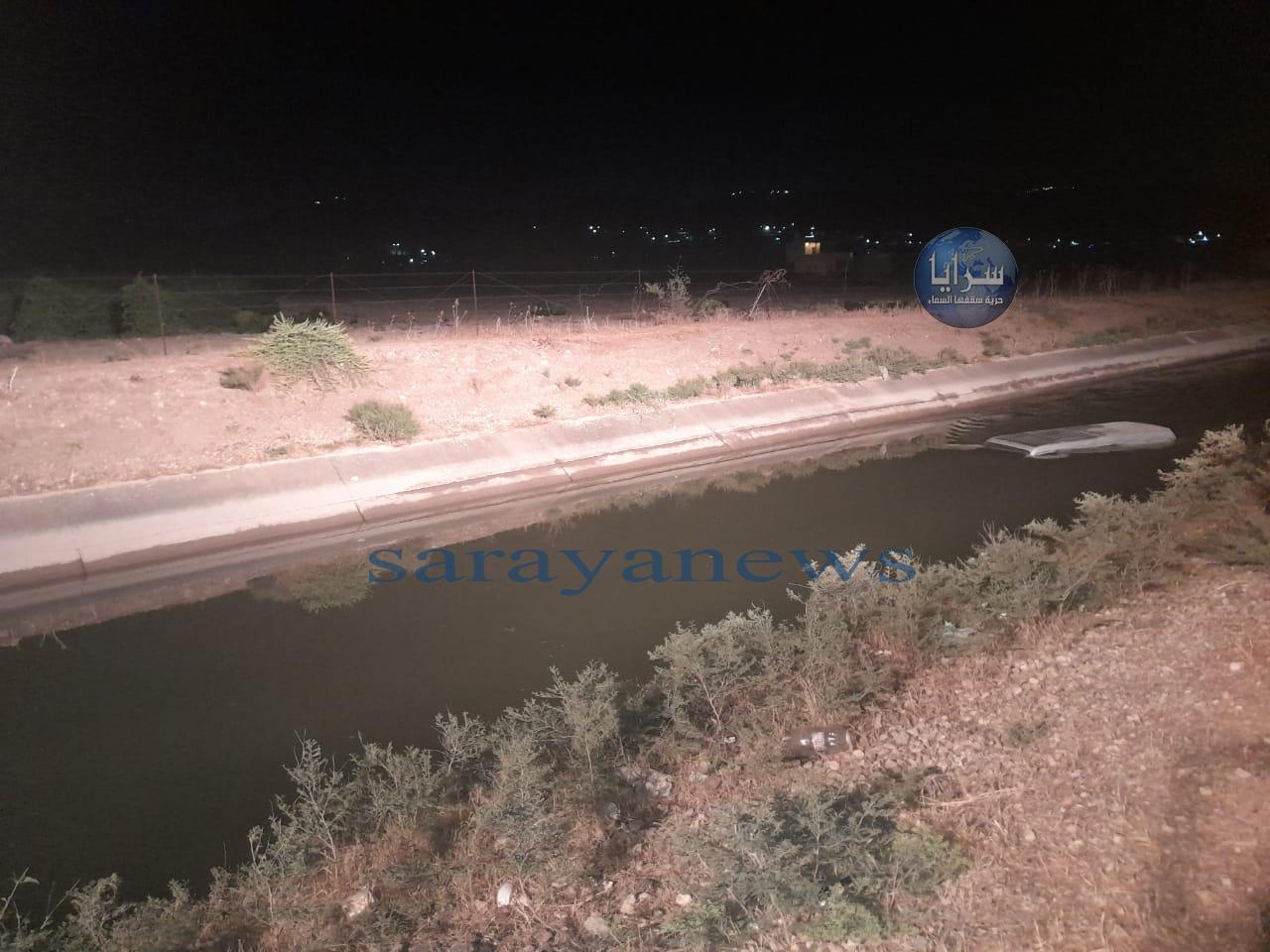 بالصور  ..  الأغوار الشمالية : تدهور مركبة في قناة الملك عبدالله بمنطقة وقاص