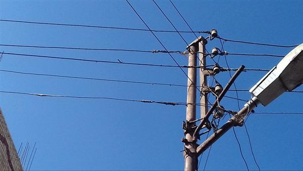 اسلاك كهرباء تهدد حياة المواطنين بسبب انخفاضها في الخالدية