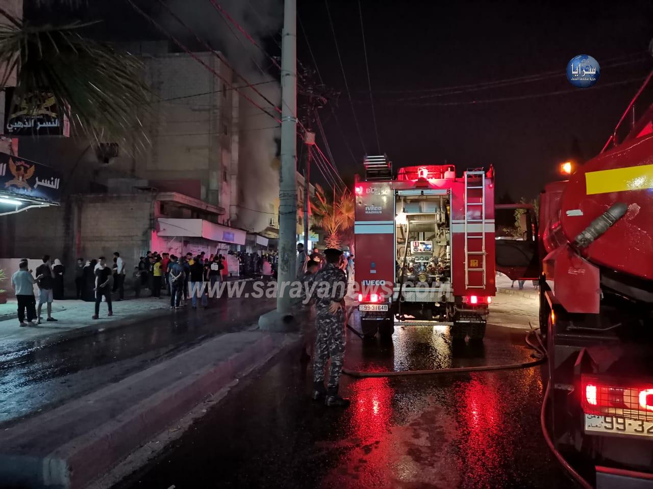 بالفيديو والصور: إخلاء بناية سكنية عقب حريق كبير داخل منجرة في اربد
