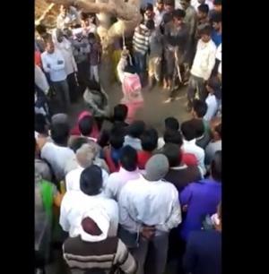 بالفيديو  ..  بعد ان خانته : زوج يجلد زوجته 100 مرة ..  و رجال يحاولون اغتصابها!