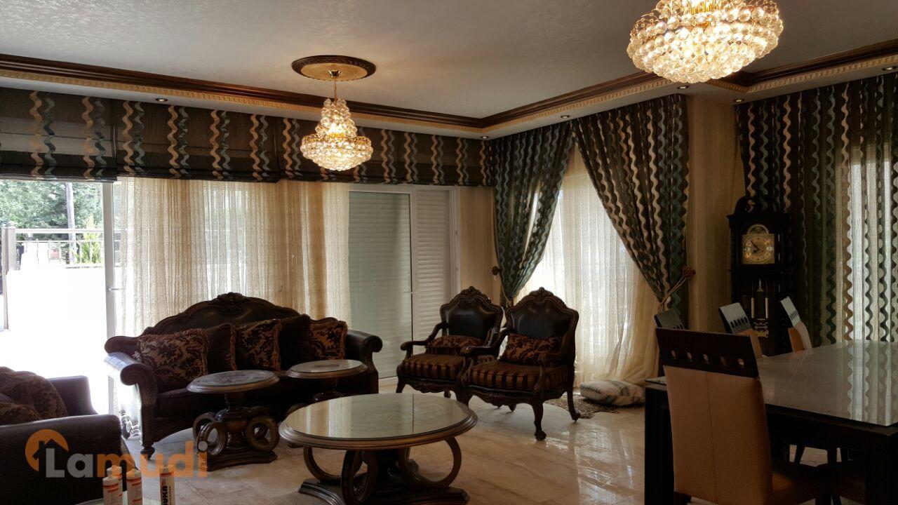شقة ارضية 227م في خلدا مع حديقة 70م بديكورات قصور للبيع بسعر مغري