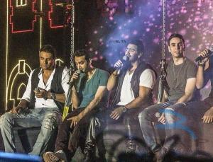 تامر حسني يشعل حفل «سموحة» ويشارك فريق «واما» الغناء.. صور