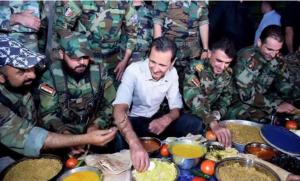 الأسد يتناول الإفطار مع جنود في الغوطة قرب دمشق