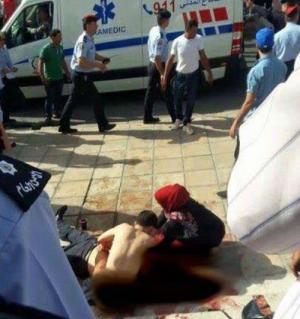بالفيديو .. من هي الفتاة المحجبة التي حاولت انقاذ حتر لحظة اصابته رغم قساوة المنظر أمامها ؟