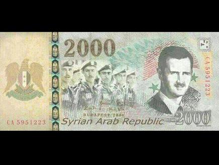 الأسد يطبع صورته على أوراق نقدية لأول مرة منذ توليه الحكم