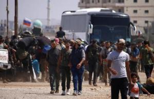 اجلاء مقاتلين معارضين من مدينة درعا نحو الشمال السوري