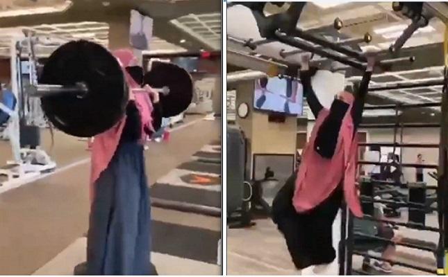شاهد  ..  منقبة مصرية ترفع الأثقال وتتسلق القوائم الحديدية داخل صالة رياضية وتثير ضجة على مواقع التواصل