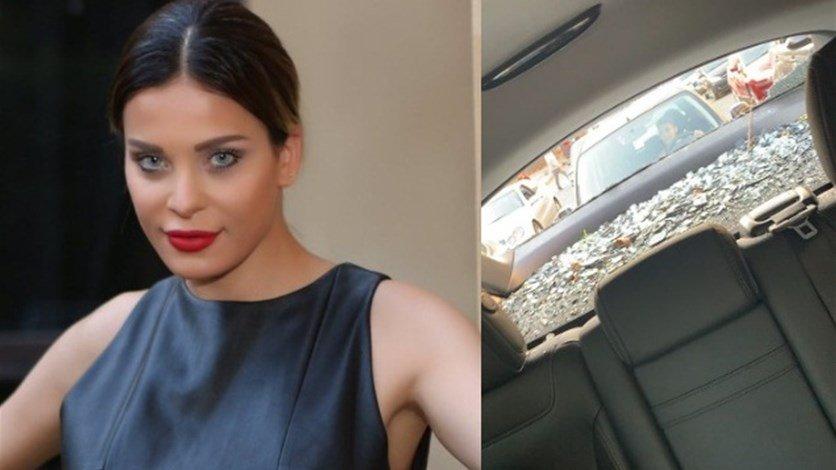 شاهدوا  ..  دومينيك حوراني تقود سيارتها المحطمة وتبكي: تكسّروا البيوت علينا
