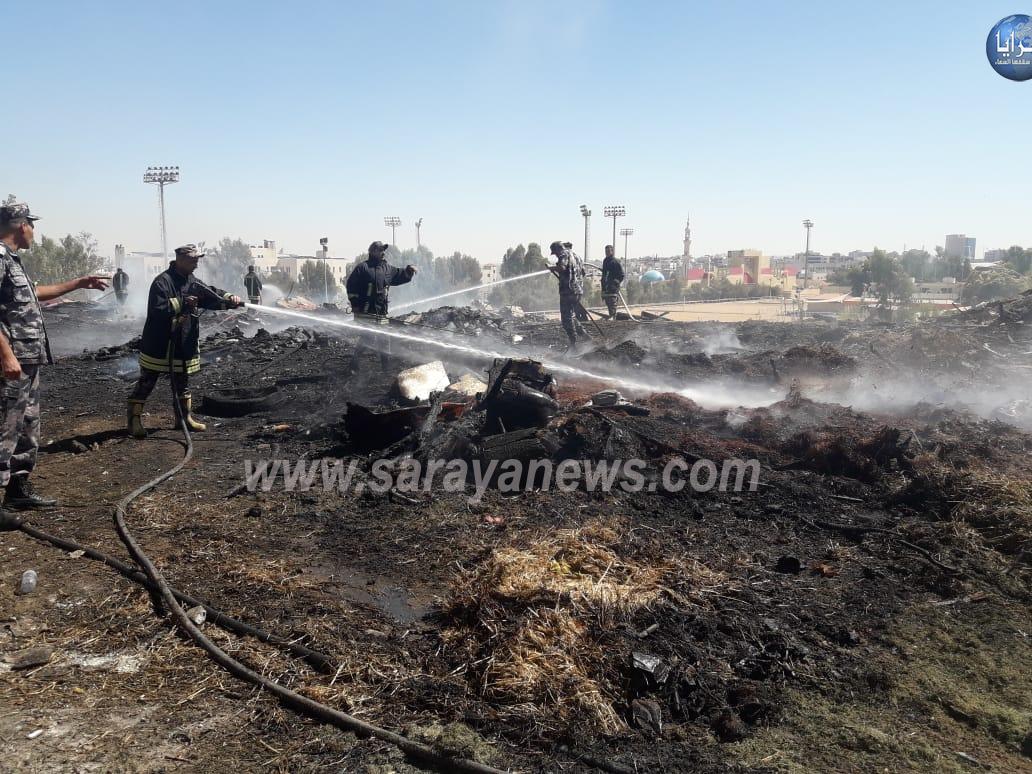 بالصور  ..  اخماد حريق اخشاب بالمدينة الرياضية