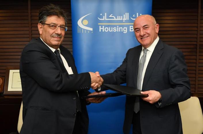 بنك الإسكان يوقع اتفاقية قرض ب 100 مليون دينار مع شركة الكهرباء الوطنية