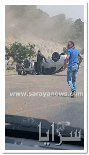 بالصور .. عمان : اصابتين بحادث انقلاب مركبة في طبربور