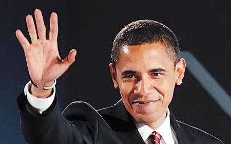 بالصور ..  باراك أوباما يعمل نجاراً في إحدى المدارس مع زوجته