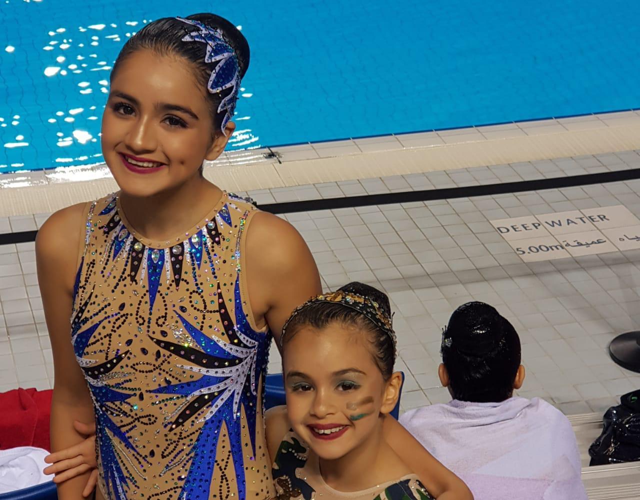 الشقيقتان ياسمينة و ريحانة ارشيدات تحرزان نتائج مميزة في رياضة باليه الماء