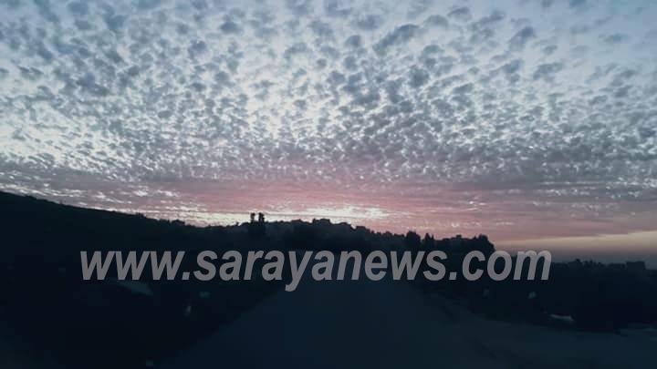 بالصور ..  شاهد مناظر خلابة وساحرة لوقت الغروب في سماء العاصمة عمان