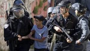 اعتقال طفل واستدعاء شاب في القدس