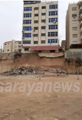 """رئيس بلدية الزرقاء لـ""""سرايا"""": انهيار جدار استنادي لاحدى العمارات يتسبب باخلاء 14 عائلة  ..  صور"""