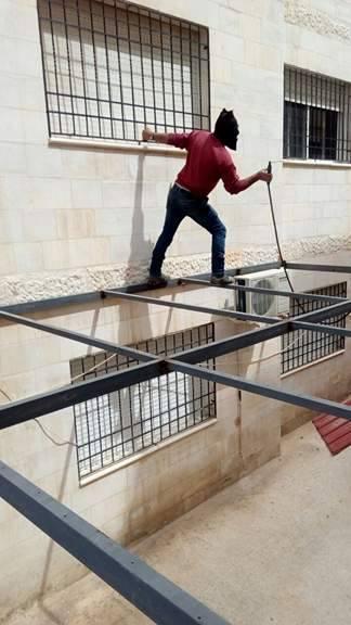 """بلدية إربد تزيل مخالفات """"بناء""""واعتداءات على الشوارع العامة ..صور"""