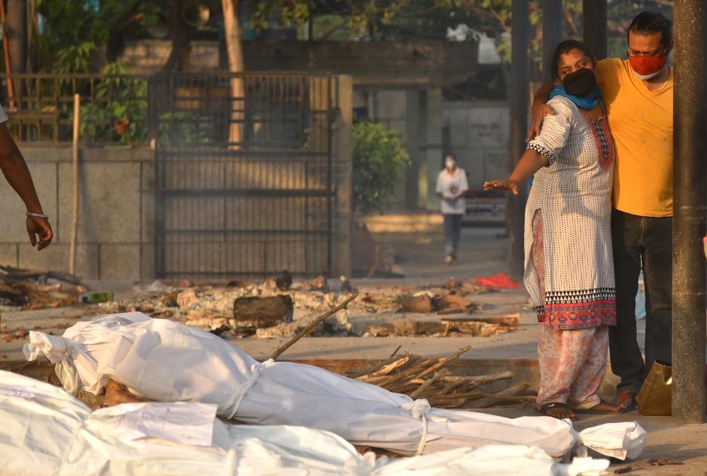 صدمة في الهند ..  عشرات الجثث لضحايا كورونا في مجرى نهر