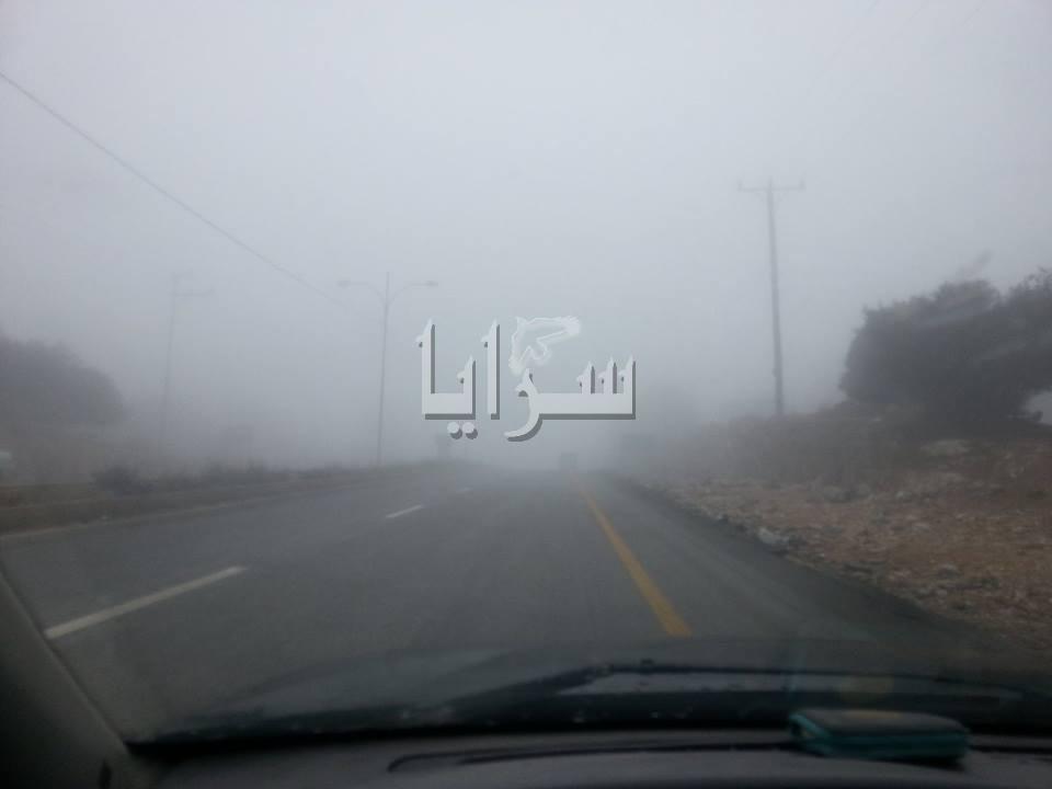 بالصور.. تدني مدى الرؤية الافقية على طريق اربد - جرش