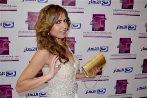 بالصور : إطلالة جديده لملكة جمال الاردن في مهرجان الإذاعة والتلفزيون