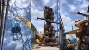 فيديو.. لحظة سقوط رافعة ضخمة على سطح بناء أثناء نقلها لخزان مياه ثقيل!