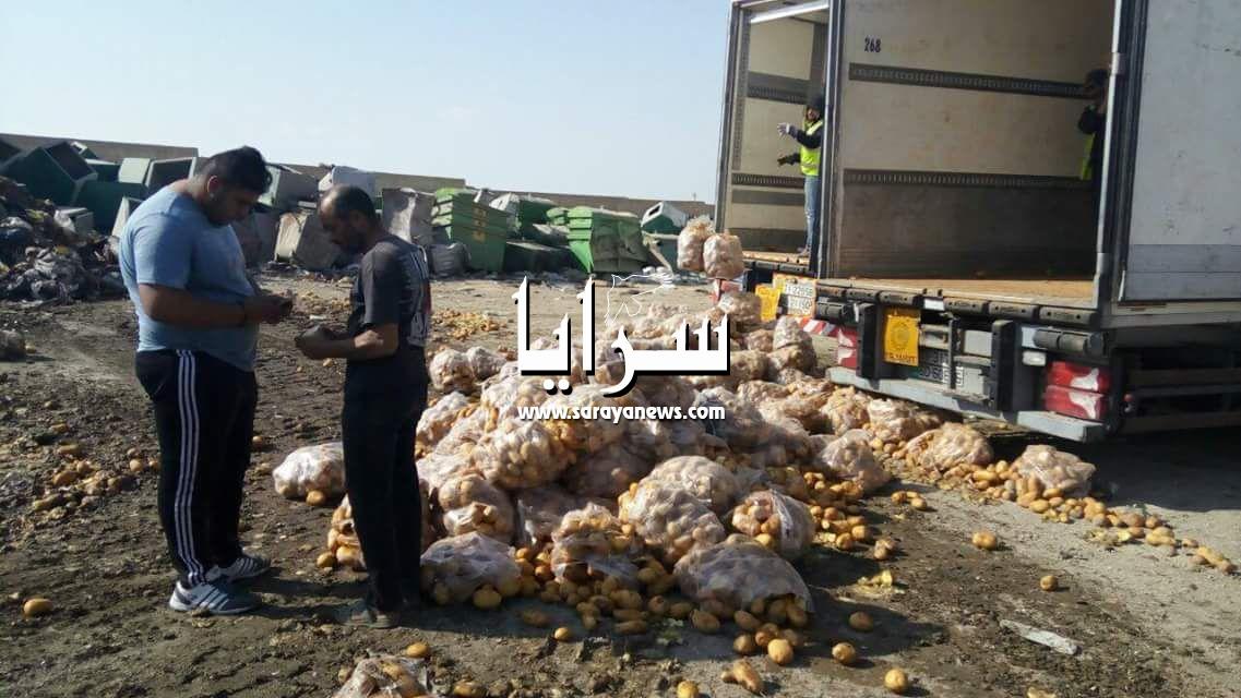بالصور ..  اربد : إتلاف 34 طن من البطاطا الفاسدة في السوق المركزي ..  والتحفظ على براد أخر