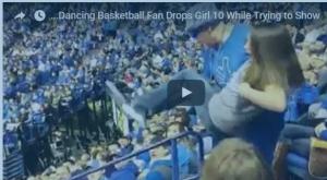 بالفيديو: لحظة سقوط طفلة من بين يدي أحد المشجعين