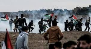 12 مصابا خلال مواجهات مع الاحتلال بغزة