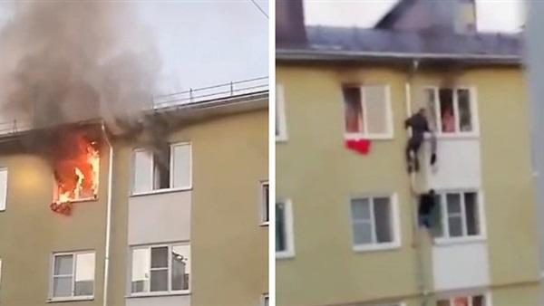 بالفيديو ..   انقاذ بطولي لـ 3 أطفال بعد اندلاع حريق في شقتهم بمدينة روسية