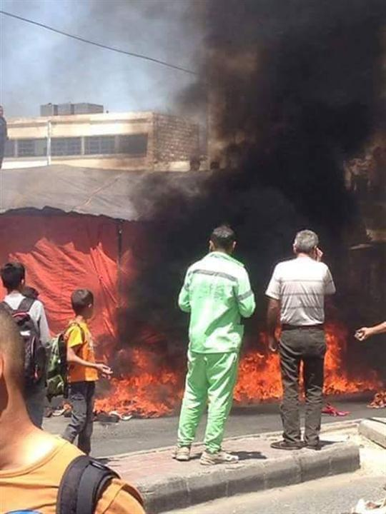 بالصور.. تجدد الاشتباكات بالوحدات.. وحريق كبير بسوق ''البالات''