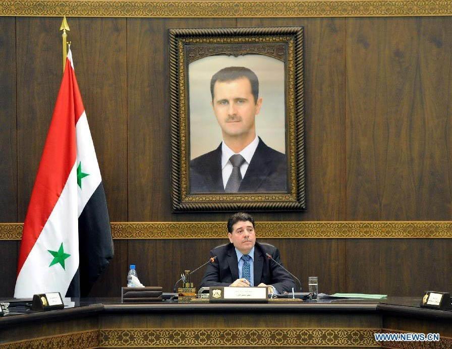 الاسد يعيد تسمية وائل الحلقي رئيسا للحكومة السورية