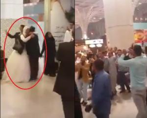 بالفيديو.. القبض على عروسين بعد ان حمل العريس زوجته استعداداً لترحيلهما في مطار المدينة المنورة