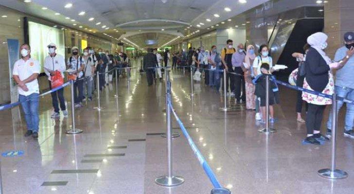 حبس موظف بمطار القاهرة اعتاد تصوير السيدات من الخلف