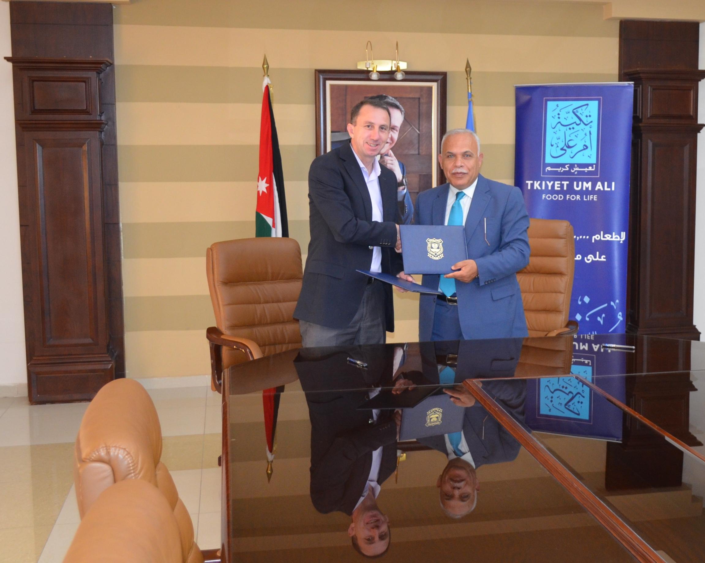 اتفاقية شراكة وتعاون بين جامعة عمان الأهلية وتكية أم علي