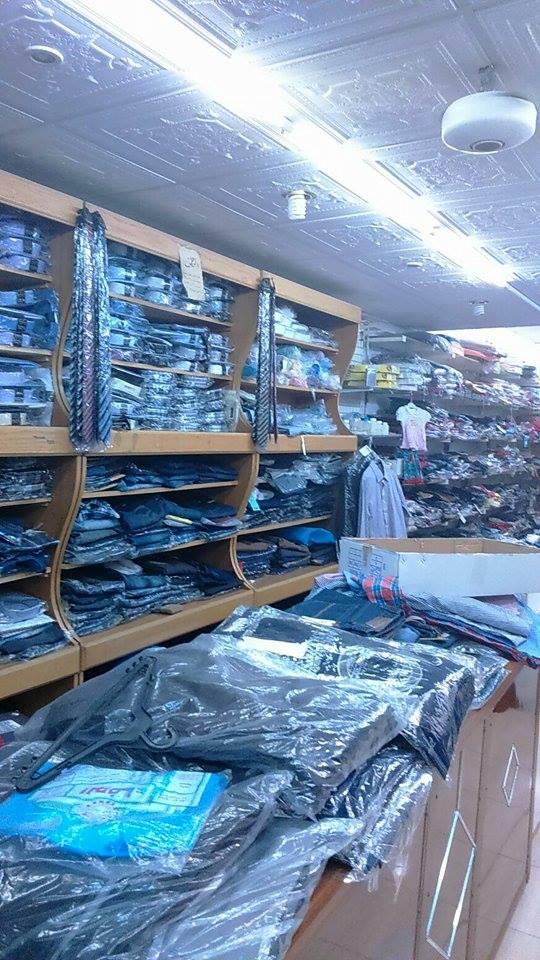 بالصور  ..  ارتفاع أسعار الملابس يحرم أطفال الكرك من فرحة العيد