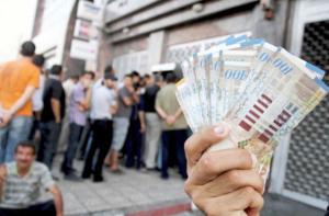 صرف رواتب موظفي غزة غدا عبر البريد