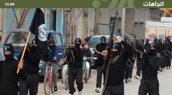 بالصور ..   بعد عام على طرده منها ..  داعش يبث الرعب في الرقة