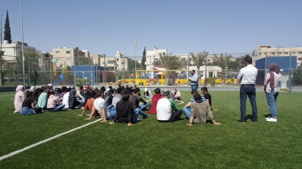 جامعة البترا تنظم يوما تطوعيا بيئيا بالتعاون مع مركز زها