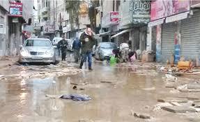 بالصور  ..  بعد قرار تعويض خساراتهم اثر فيضانات فصل الشتاء  ..  تجار وسط البلد يحتفلون