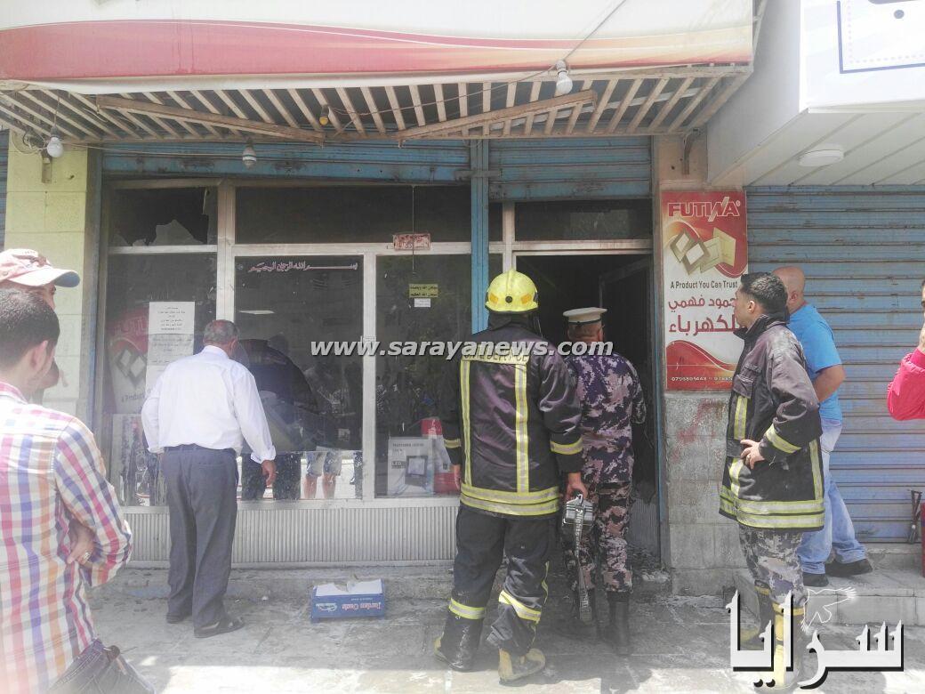 بالصور .. حريق يلتهم محل تجاري في شارع الـ(16)