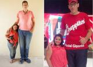 صور: برازيلي طوله مترين يتزوج فتاة بنصف حجمه