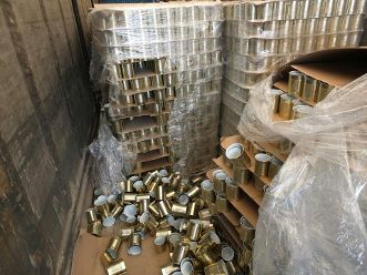 بالصور...إحباط تهريب 650 ألف حبة مخدر  وضعت في معلبات فارغة