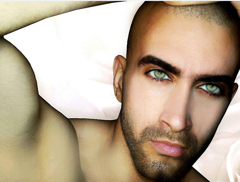 بالصور .. أردني يفوز بأجمل عيون عربية